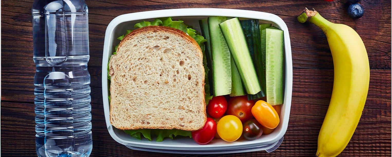 Healthy school lunch with sandwich and fruit