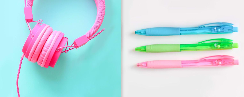 Pink headphones and neon pens