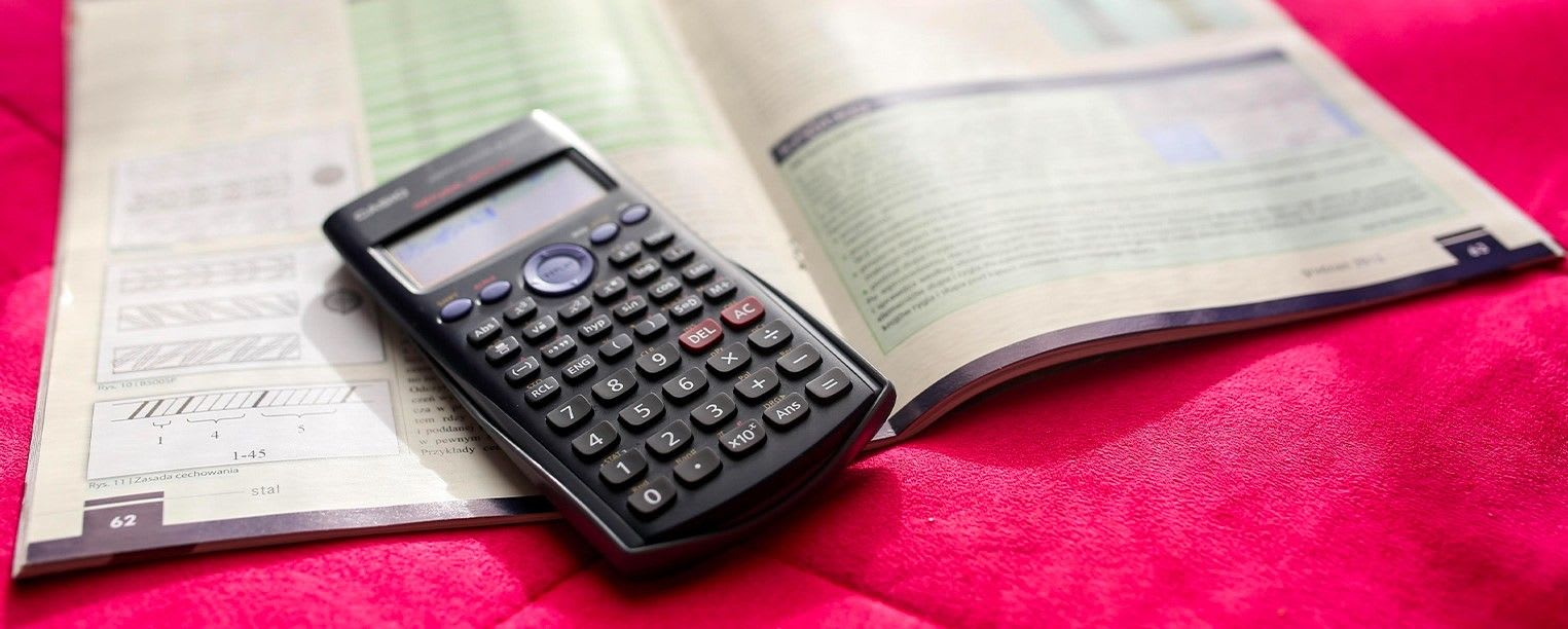 Scientific calculator and math workbook
